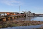 BNSF 9133, 6102 & 969 bring general freight west over the dual purpose Mississippi River bridge
