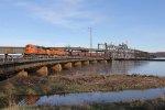 H-NTWKCK1 rolls off the swing bridge over the Mississippi