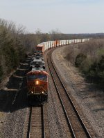 With clear signals and nothing in the way, BNSF 7012 races west leading Z-CHISBD6