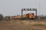 BNSF 7905 rolls west under the 241 signals with a military equipment train