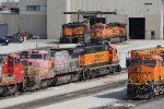 BNSF 555 & 2892 sit among other units