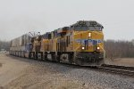 Four units running elephant style lead UP's ZG4CI west on trackage rights