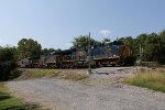 With space in the yard now available, Q696 starts pulling south again