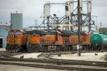 BNSF6560, BNSF3833, CREX1418 and BNSF5319 outside the depot
