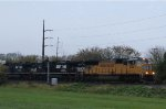 UP 4124 leads NS 212 eastbound on a cool, rainy morning