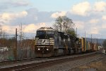 NS 8394 leads train 15T westbound