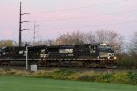 NS 9738 leads train 20E eastbound early in the morning