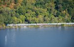 A Metro-North train cruises north along the Hudson