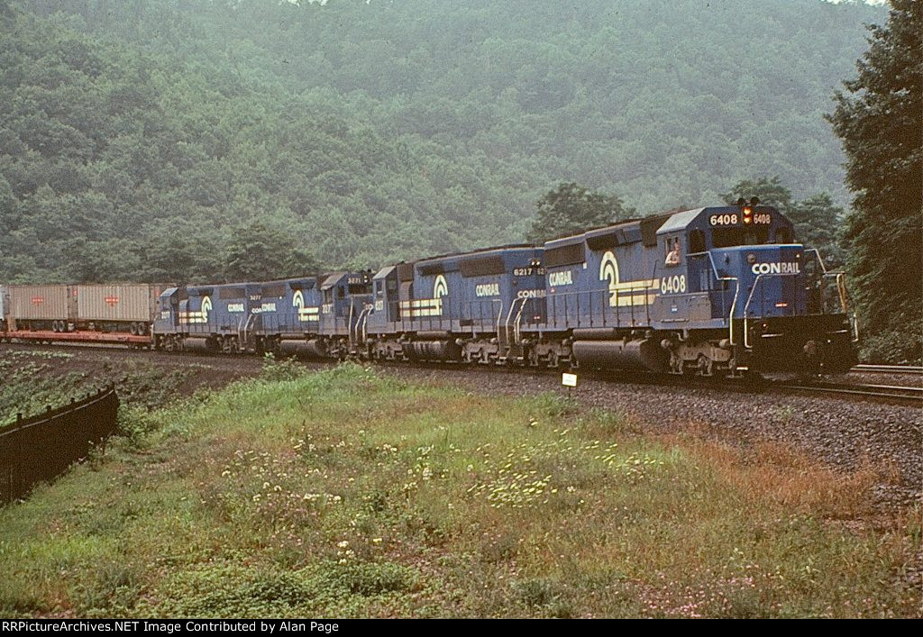 CR SD40-2 6408 and SD45 6217 provide much needed braking assist to a hot TV train
