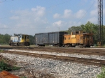CSX 1217 kicking cars and a caboose