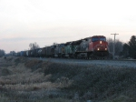 CN 2585 leading M395 west just before sunrise