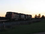 CN 5243 & 2630 with WC 6924 rolling into the sunset