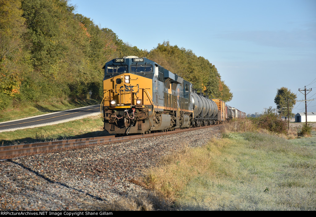 CSX 3010 Leads a morning freight in the fall air.