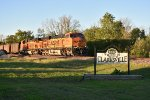 BNSF 5784 Rolls by the welcome sign to Clarksville Mo.