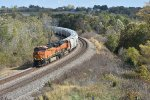 BNSF 7387 Leans into the curve with a sand train.