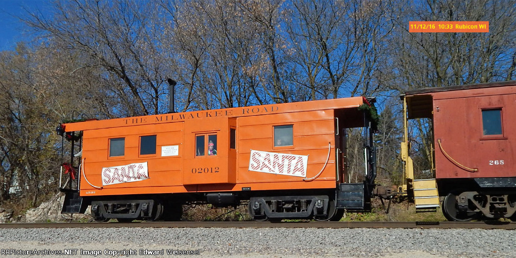 Elf in the bay window of the preserved Milwaukee Road rib-side caboose