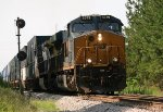 CSX ES44AH 3079 leads C40-8W 7885 and NB doublestacks past the old S.E. Peachtree City signal