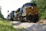 CSX ES44AH 3079 leads C40-8W 7885 NB past the old S.E. Peachtree City signal