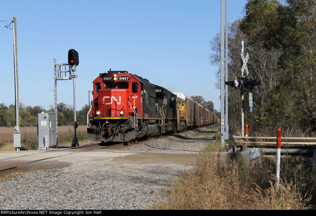 Flying past the intermediate at mile 259, CN 5447 leads M397 west