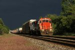 GTW 4926 & 4912 slowly pull east on Main 1 as dark storm clouds move in