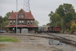 Passing the depot, CN 2110 & 5319 roll into the Chicago Wye with A451