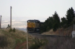 UP 8234 is trailing the coal loads down to the ground below