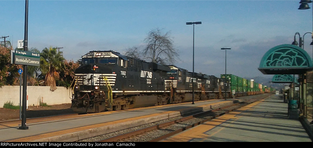 NS NS 7682 leads NS 9883, NS 7521, and NS 9307 through Montebello, CA on its way to LATC