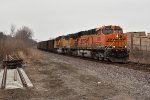BNSF 6099 Leads a coal load down the K line.