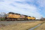 WB UP freight w/ an SD60 trailing