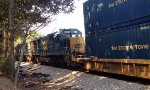 CSX SD50-2's 8576 and 8520 round the curve