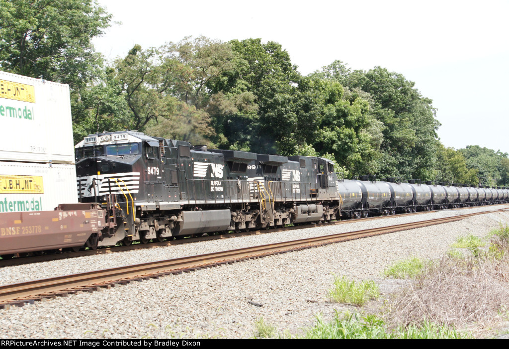 NS 9911 and 9479 over take a tank train