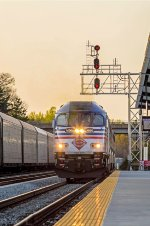 VRE P311 pulls into the Spotsy VRE Station as the rear of P053 passes by.