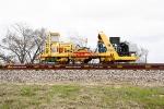 BNSF X5300098 Harsco Drone Tamper DT2AJ2, BNSF 927357 89' MOW Flat