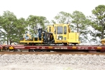 BNSF X4400400 Nordco Production Spike Driver, BNSF 927353 89' MOW Flat