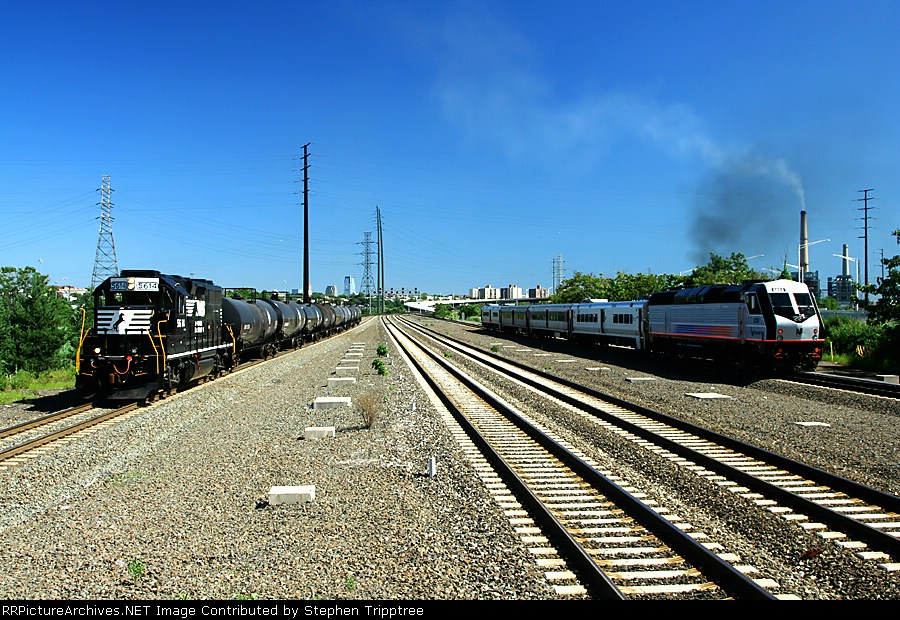 NS 5614 pulls west as NJT 4011? pushes east.