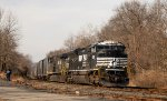 NS 1136 leads emptry trash train 62V