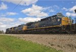 CSX SD70AC 4571 leads C40-8W's 7833 and Monon Heritage 7670