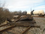 looking northeast at pile of ties at east end of wye & at UP 9048 heading south