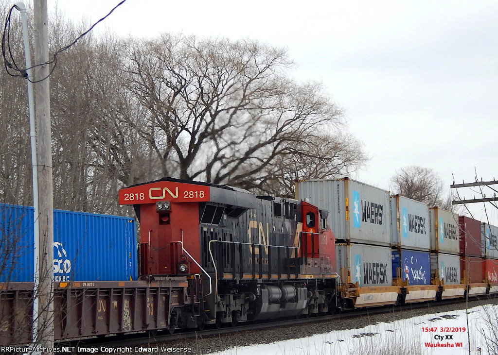 Mid-train with CN 3004 leading north