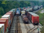 Long intermodal on the main, interchange cars for WSOR in the yard - and A446 threads thru the siding