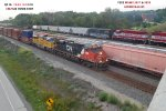 CN's Q116 and WSOR's Y202 both roll southwest beneath the WI 164 bridge just south of Slinger