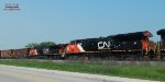 Meeting Q117, the southbound manifest rolls into the siding