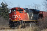 DPU with Canadian oil loads tied down @ mp 310 east of Marcy Road on the UP Adams sub