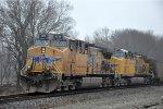 Rear Dpus push coal train east
