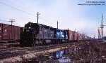 Conrail SD35 6012 (built 1965 as PRR 6012) and GP40 3116 westbound at Dolton, Illinois - March 23, 1978.