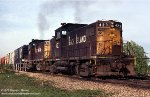 CRI&P Alco C-415s 423 and 420 pulling on a cut over the IHB and B&OCT in Blue Island, Illinois - April 23, 1977.