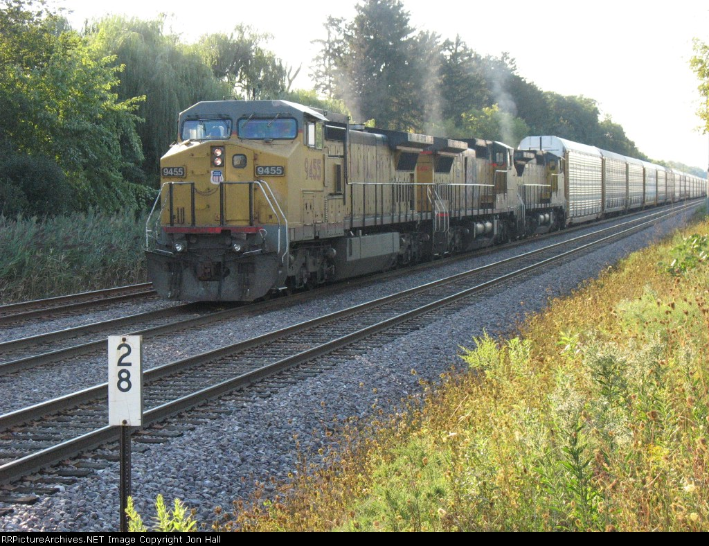APRPR sits short of the Baldwin Road crossing with autoracks from Janesville