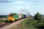 BN wide-vision caboose 12525 brings up the rear of a short freight on the Hannibal Subdivision over Kissenger Hill near Clarksville, Missouri - May 27, 1992. The smoking Frisco power on the headend has somehow avoided getting painted into Cascade Green, e
