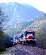LMX B39-8E 8553 (built 1988 became Montreal Maine and Atlantic 8553) westbound with BN stacks crossing the Skykomish River at MP 1751 on the Burlington Northern Scenic Subdivision near Index, Washington - March 24, 1992.