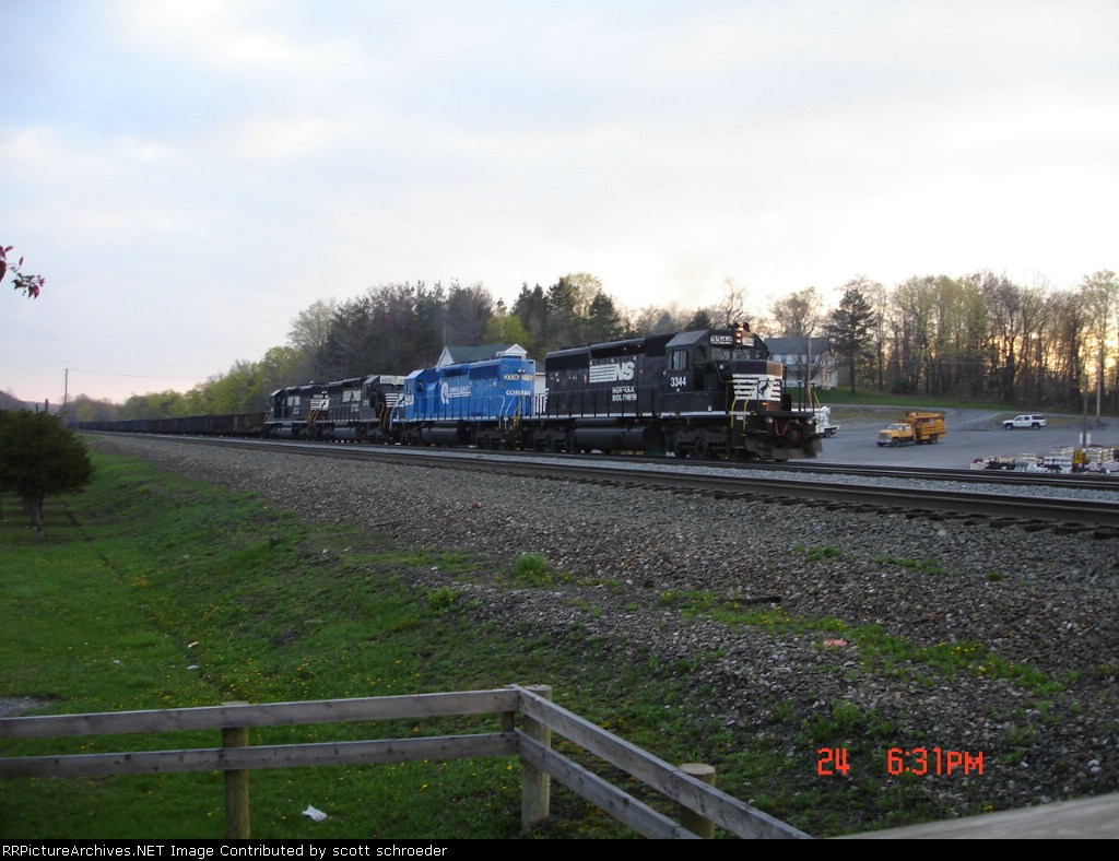 4 SD40-2's push this steel slab gondola train WB
